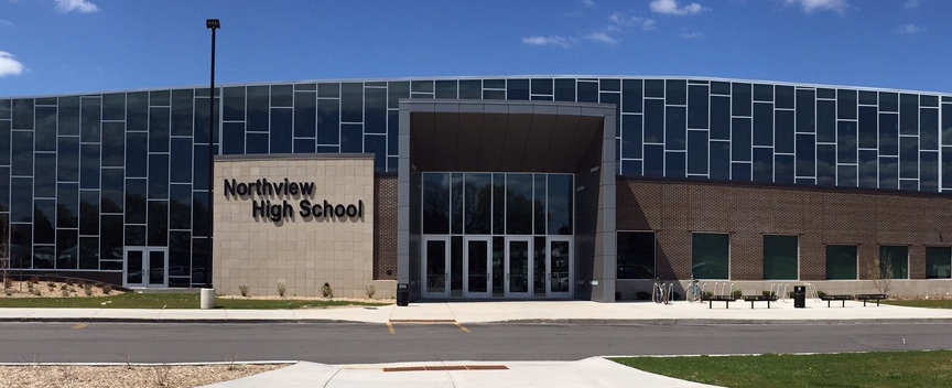 A wide angle photo of the front of the redesigned High School.