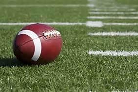 football laying on football field