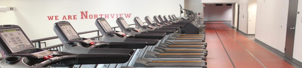 Northviews Fitness Center has many treadmills on the second story over looking the first floor.