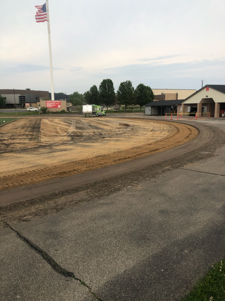 A photo of the demolished track behind the High School.